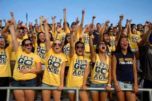 Students cheering at the Aggie Stadium