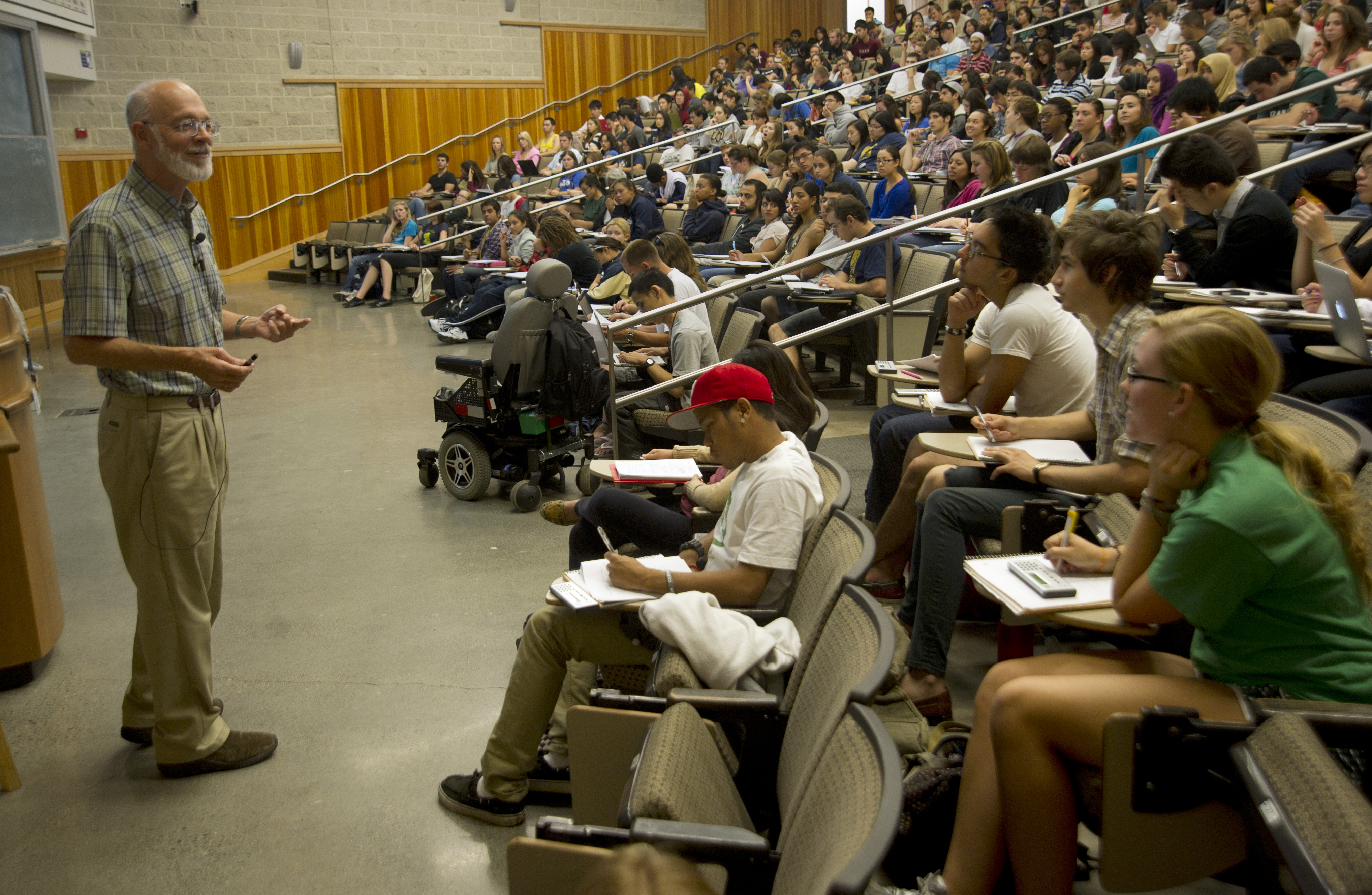 Professor instructing students during a lecture